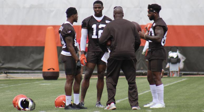 Corey Coleman, Josh, Gordon and Jarvis Landry chat with receivers coach Adam Henry during practice.