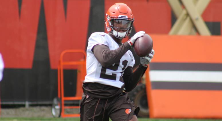 Browns rookie cornerback Denzel Ward catches a ball as part of an interception drill during June minicamp
