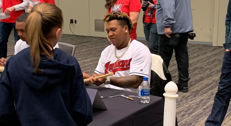Jose Ramirez signs for a young fan
