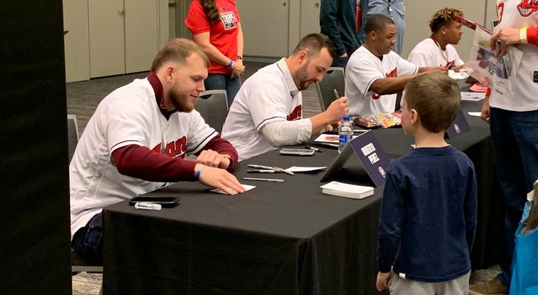 Roberto Perez signs for a young fan
