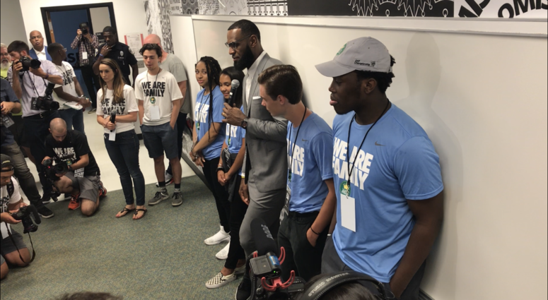 Akron, OH - LeBron James addresses the media following the official opening of his I Promise School.