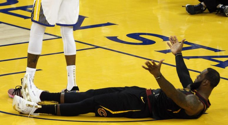 LeBron James (23) reacts after Golden State Warriors forward Kevin Durant (35) collides with him during the second half in game one of the 2018 NBA Finals at Oracle Arena.