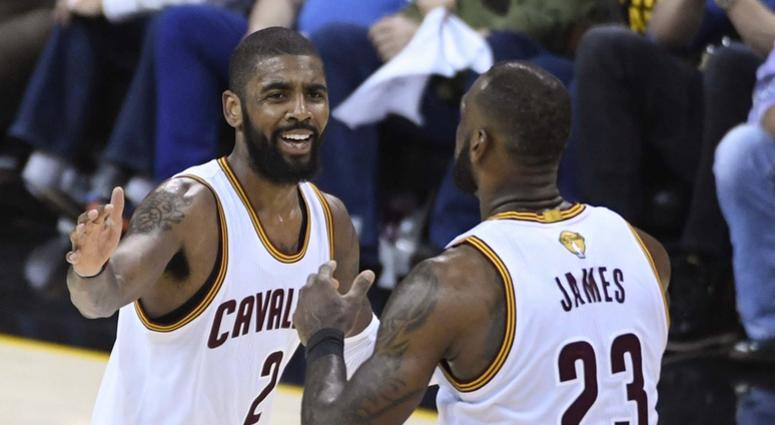 1708962bfcd Cleveland Cavaliers guard Kyrie Irving (2) celebrates with forward LeBron  James (23)