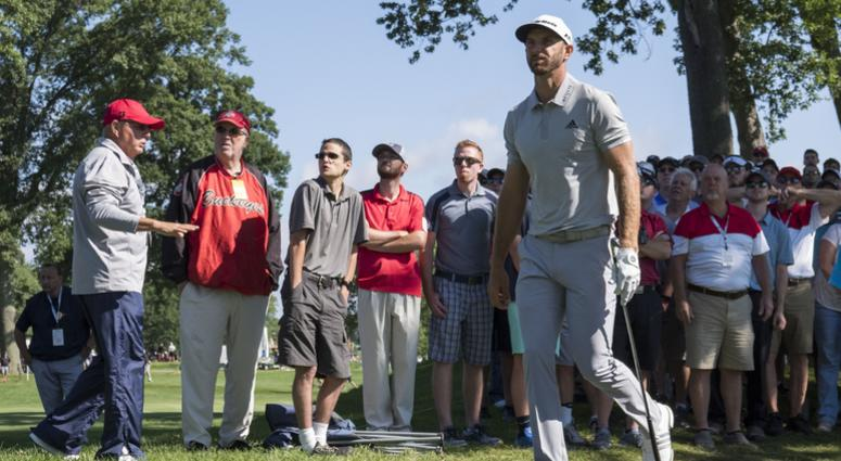 August 5, 2017; Akron, OH, USA; Dustin Johnson walks after his shot from the rough on the second hole during the third round of the WGC - Bridgestone Invitational golf tournament at Firestone Country Club - South Course.
