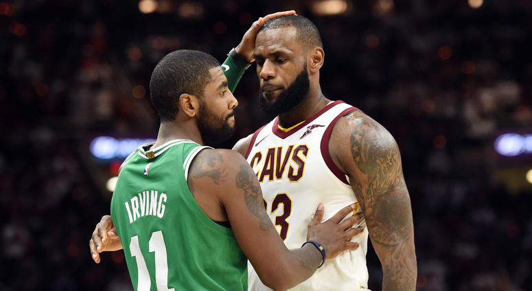 Oct 17, 2017; Cleveland, OH, USA; Cleveland Cavaliers forward LeBron James (23) and Boston Celtics guard Kyrie Irving (11) meet after the Cavs beat the Celtics 102-99 at Quicken Loans Arena. Mandatory Credit: Ken Blaze-USA TODAY Sports