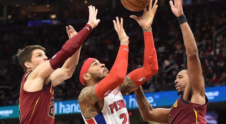 Jan 28, 2018; Cleveland, OH, USA; Detroit Pistons forward Eric Moreland (24) drives to the basket between Cleveland Cavaliers guard Kyle Korver (26) and forward Channing Frye (8) during the first half at Quicken Loans Arena.