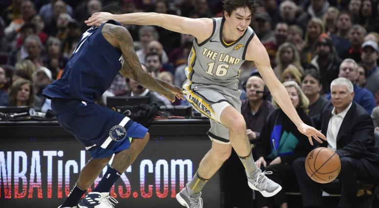 Cleveland Cavaliers forward Cedi Osman (16) drives against Minnesota Timberwolves guard Jamal Crawford (11) in the fourth quarter at Quicken Loans Arena.