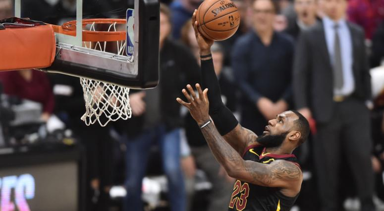 5919c7eebab9 Cavaliers forward LeBron James (23) scores on a layup during the first half  against