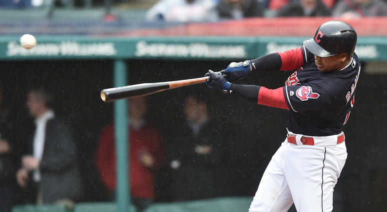 Apr 24, 2018; Cleveland, OH, USA; Cleveland Indians third baseman Jose Ramirez (11) hits a single during the first inning against the Chicago Cubs at Progressive Field.