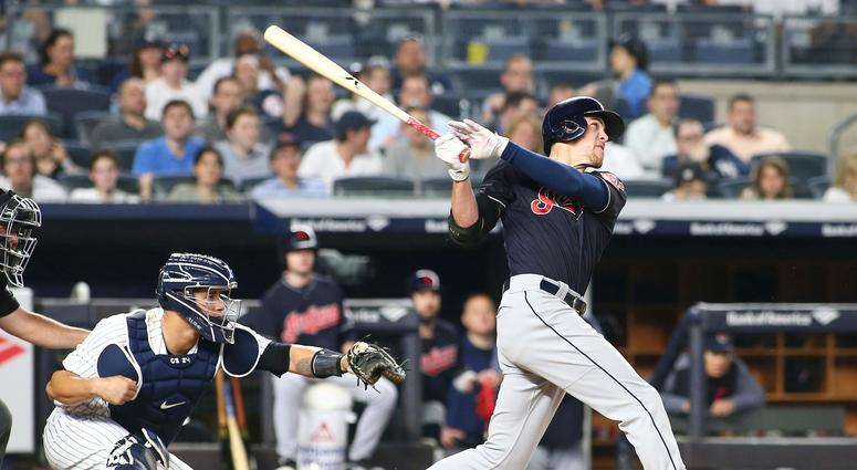 May 4, 2018; Bronx, NY, USA; Cleveland Indians center fielder Bradley Zimmer (4) hits a three run home run against the New York Yankees during the eighth inning at Yankee Stadium.