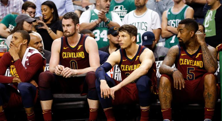 Cavaliers center Kevin Love (0), guard Kyle Korver (26), and guard JR Smith (5) watch the end of the fourth quarter against the Boston Celtics in game two of the Eastern conference finals of the 2018 NBA Playoffs at TD Garden.