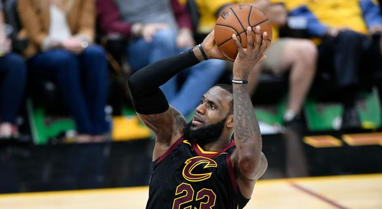 Cavaliers forward LeBron James (23) attempts a basket in front of Boston Celtics forward Jayson Tatum (0) during the second quarter in game four of the Eastern conference finals of the 2018 NBA Playoffs at Quicken Loans Arena.