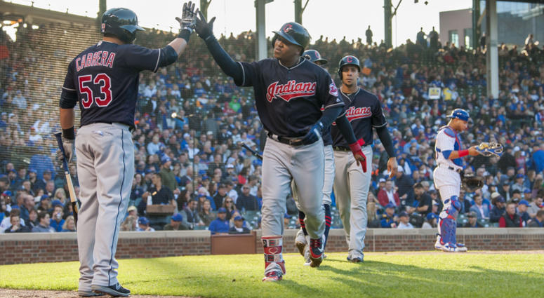 May 22, 2018; Chicago, IL, USA; Cleveland Indians third baseman Jose Ramirez (11) celebrates his three run home run with right fielder Melky Cabrera (53) during the third inning against the Chicago Cubs at Wrigley Field.