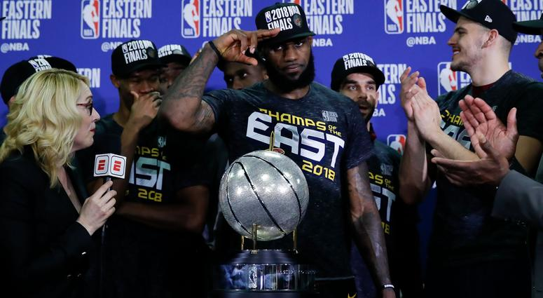 Cleveland Cavaliers forward LeBron James solutes in front of the Eastern  Conference trophy after defeating the 162350a672b