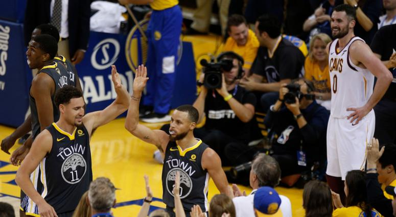 Jun 3, 2018; Oakland, CA, USA; Golden State Warriors guard Klay Thompson (11) and guard Stephen Curry (30) celebrate in front of Cleveland Cavaliers center Kevin Love (0) during the second half in game two of the 2018 NBA Finals at Oracle Arena.