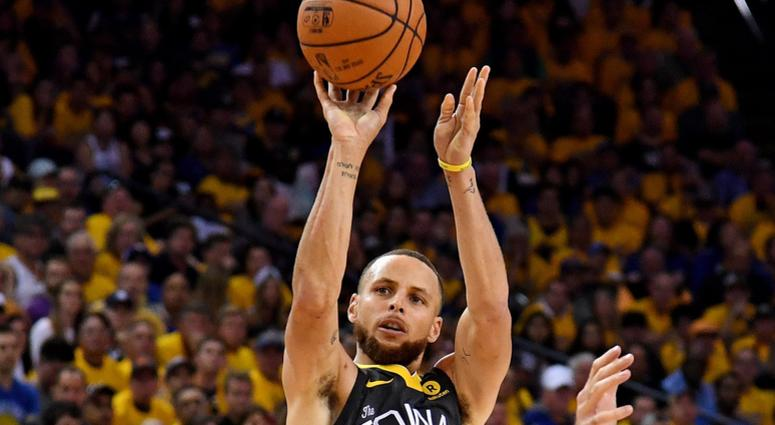 Golden State Warriors guard Stephen Curry (30) shoots the ball against Cleveland Cavaliers forward Larry Nance Jr. (22) during the fourth quarter in game two of the 2018 NBA Finals at Oracle Arena.