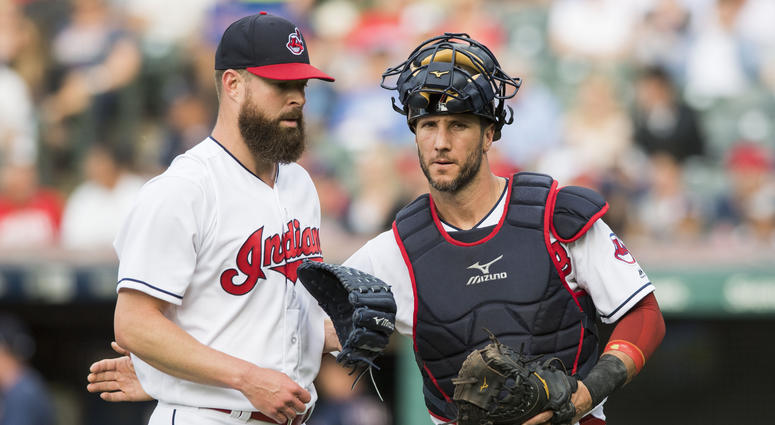 Jun 15, 2018; Cleveland, OH, USA; Cleveland Indians catcher Yan Gomes (7) talks with starting pitcher Corey Kluber (28) as they leave the field during the first inning against the Minnesota Twins at Progressive Field.