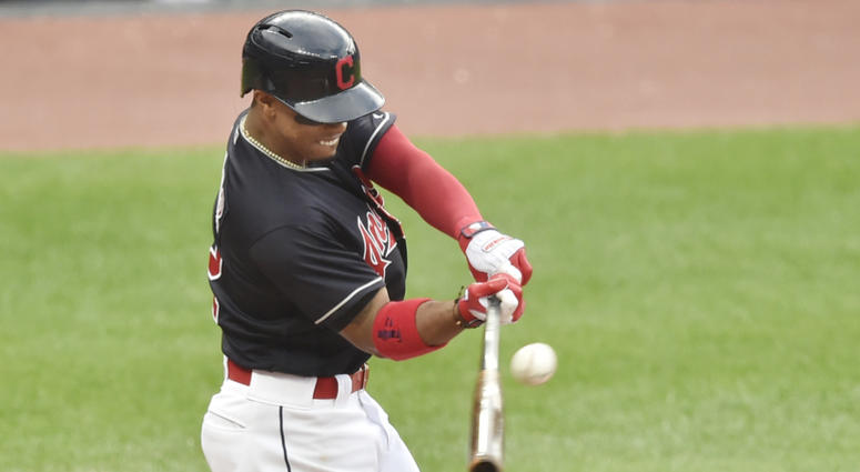 Jun 19, 2018; Cleveland, OH, USA; Cleveland Indians shortstop Francisco Lindor (12) hits a two-RBI single in the second inning against the Chicago White Sox at Progressive Field.
