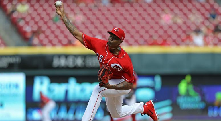 Cincinnati Reds relief pitcher Raisel Iglesias (26) throws against the Milwaukee Brewers in the ninth inning at Great American Ball Park.