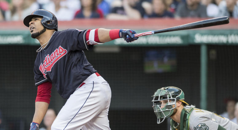 Jul 6, 2018; Cleveland, OH, USA; Cleveland Indians designated hitter Edwin Encarnacion (10) hits a sacrifice fly during the third inning against the Oakland Athletics at Progressive Field.