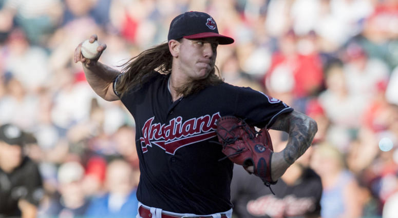 Jul 9, 2018; Cleveland, OH, USA; Cleveland Indians starting pitcher Mike Clevinger (52) throws a pitch during the second inning against the Cincinnati Reds at Progressive Field.