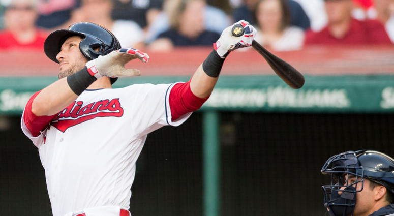 Jul 13, 2018; Cleveland, OH, USA; Cleveland Indians catcher Yan Gomes (7) hits an RBI double during the second inning against the New York Yankees at Progressive Field.