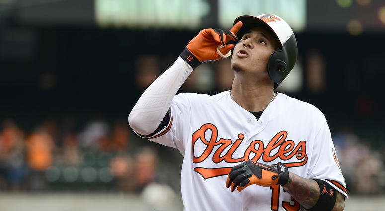 Baltimore Orioles shortstop Manny Machado (13) celebrates after hitting a solo home run in the first inning against the Texas Rangers at Oriole Park at Camden Yards.