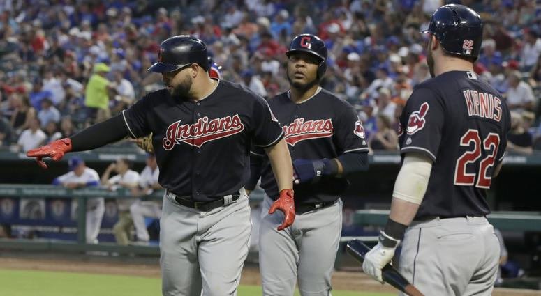 Cleveland Indians first baseman Yonder Alonso (17) reacts after hitting a home run that scored designated hitter Edwin Encarnacion (10) in the fifth inning against the Texas Rangers at Globe Life Park in Arlington.