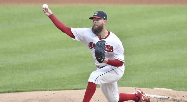 Jul 23, 2018; Cleveland, OH, USA; Cleveland Indians starting pitcher Corey Kluber (28) delivers in the first inning against the Pittsburgh Pirates at Progressive Field.