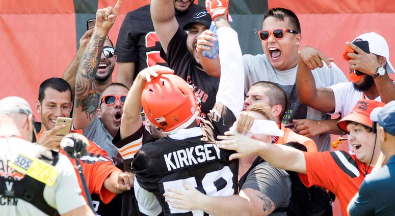 Fans greet Cleveland Browns linebacker Christian Kirksey (58) during training camp at the Cleveland Browns Training Complex.