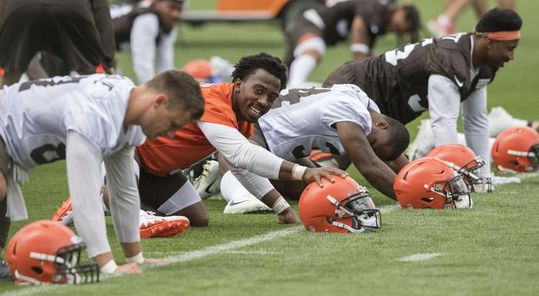 leveland Browns tight end Seth DeValvle (87) and quarterback Tyrod Taylor (5) and running back Carlos Hyde (34) and defensive end Myles Garrett (95) stretch during training camp