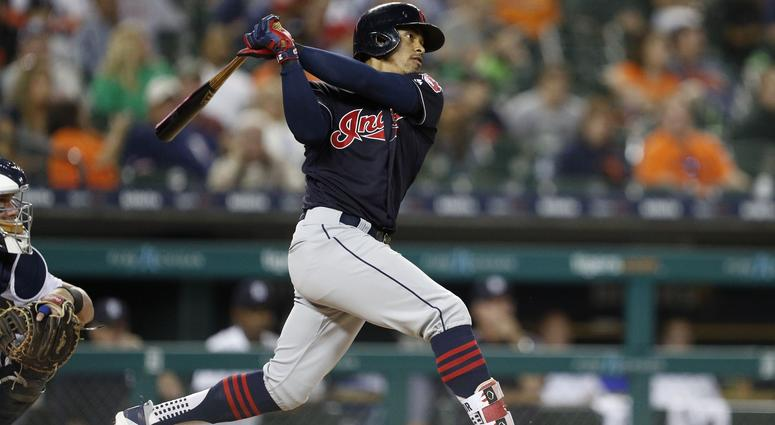 Cleveland Indians shortstop Francisco Lindor (12) hits a solo home run during the ninth inning against the Detroit Tigers at Comerica Park.