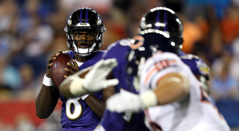 Aug 2, 2018; Canton, OH, USA; Baltimore Ravens quarterback Lamar Jackson (8) looks to pass against the Chicago Bears in the second half at Tom Benson Hall of Fame Stadium. Mandatory Credit: Aaron Doster-USA TODAY Sports
