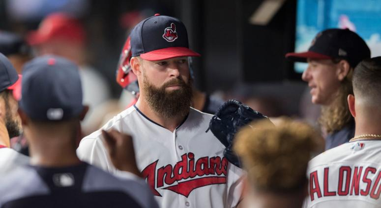 Aug 4, 2018; Cleveland, OH, USA; Cleveland Indians starting pitcher Corey Kluber (28) celebrates in the dugout after pitching the eighth inning against the Los Angeles Angels at Progressive Field.