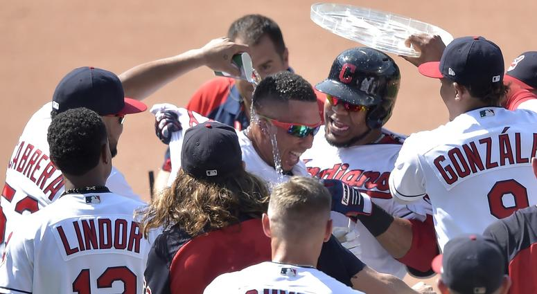 Aug 9, 2018; Cleveland, OH, USA; Cleveland Indians left fielder Michael Brantley (23), center, celebrates his game-winning single in the ninth inning against the Minnesota Twins at Progressive Field. Mandatory Credit: David Richard-USA TODAY Sports