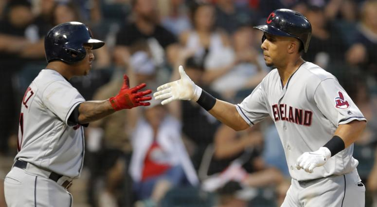 Aug 11, 2018; Chicago, IL, USA; Cleveland Indians left fielder Michael Brantley (23) celebrates his home run against the Chicago White Sox with Cleveland Indians third baseman Jose Ramirez (11) during the sixth inning at Guaranteed Rate Field.