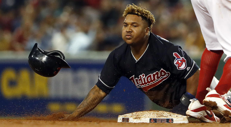 Aug 21, 2018; Boston, MA, USA; Cleveland Indians third baseman Jose Ramirez (11) steals second base safely as the throw goes into center field during the seventh inning at Fenway Park.