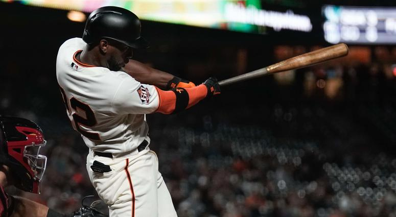 Aug 29, 2018; San Francisco, CA, USA; San Francisco Giants center fielder Andrew McCutchen (22) hits a RBI single against the Arizona Diamondbacks during the eighth inning at AT&T Park.