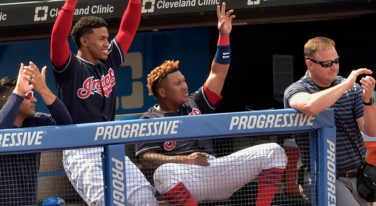 Aug 30, 2018; Cleveland, OH, USA; Cleveland Indians shortstop Francisco Lindor (12) and third baseman Jose Ramirez (11) celebrate in the sixth inning against the Minnesota Twins at Progressive Field.
