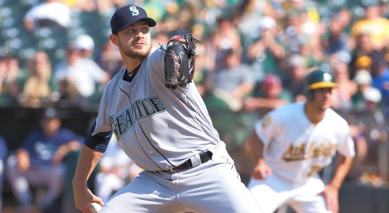 Sep 2, 2018; Oakland, CA, USA; Seattle Mariners relief pitcher Justin Grimm (57) pitches the ball against the Oakland Athletics during the eighth inning at Oakland Coliseum. Mandatory Credit: Kelley L Cox-USA TODAY Sports