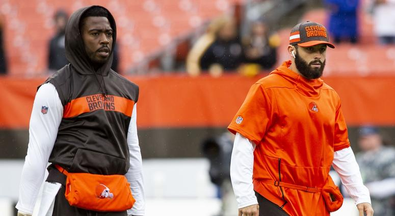 Cleveland Browns quarterbacks Tyrod Taylor, left, and Baker Mayfield, right, during warmups before the game at FirstEnergy Stadium.