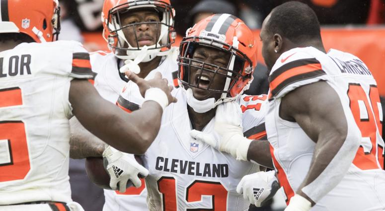 Cleveland Browns wide receiver Josh Gordon (12) celebrates with quarterback Tyrod Taylor (5) and defensive tackle Devaroe Lawrence (99) after catching a touchdown during the fourth quarter at FirstEnergy Stadium.