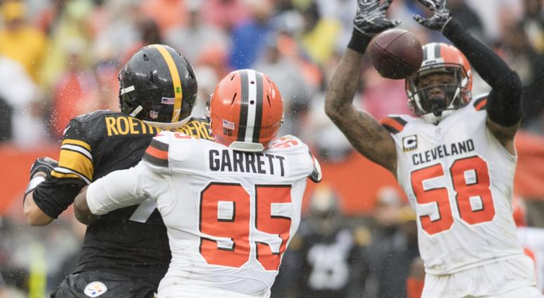 Cleveland Browns defensive end Myles Garrett (95) forces a fumble from Pittsburgh Steelers quarterback Ben Roethlisberger (7) as linebacker Christian Kirksey (58) goes for the ball during the second half at FirstEnergy Stadium.