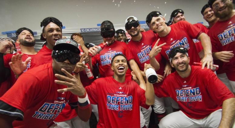 Sep 15, 2018; Cleveland, OH, USA; Members of the Cleveland Indians including shortstop Francisco Lindor (center) and center fielder Rajai Davis (left) celebrate after defeating the Detroit Tigers to clinch the American League Central Division at Progressi