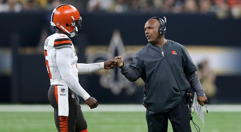 Cleveland Browns quarterback Tyrod Taylor (5) gets a fist bump from head coach Hue Jackson in the second quarter against the New Orleans Saints at Mercedes-Benz Superdome.