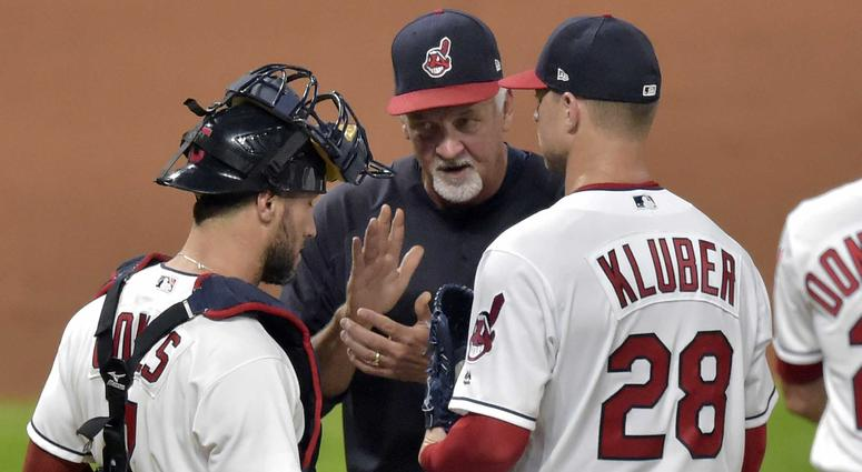 Sep 18, 2018; Cleveland, OH, USA; Cleveland Indians pitching coach Carl Willis (51) talks to catcher Yan Gomes (7) and starting pitcher Corey Kluber (28) in the eighth inning against the Chicago White Sox at Progressive Field.