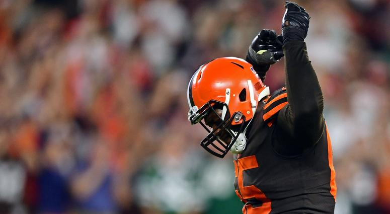 Cleveland Browns defensive tackle Larry Ogunjobi (65) celebrates after a Cleveland Browns linebacker Joe Schobert (53) interception during the second half of a game against the New York Jets at FirstEnergy Stadium.