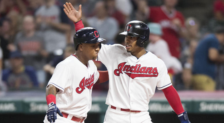Sep 21, 2018; Cleveland, OH, USA; Cleveland Indians shortstop Francisco Lindor, right, celebrates with second baseman Jose Ramirez (11) after scoring on a sacrifice fly by Ramirez during the fifth inning against the Boston Red Sox at Progressive Field. Ma