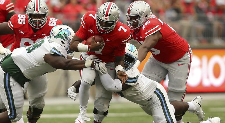 Ohio State Buckeyes quarterback Dwayne Haskins (7) tackled by Tulane Green Wave nose tackle De'Andre Williams (left) and defensive end Juan Monjarres (44) during the first quarter at Ohio Stadium.