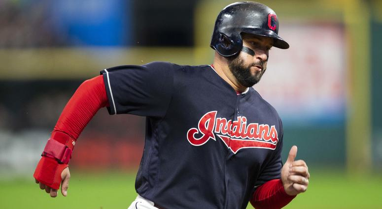 Sep 23, 2018; Cleveland, OH, USA; Cleveland Indians first baseman Yonder Alonso (17) runs toward home plate on a two-run hit by left fielder Michael Brantley (23) during the fourth inning against the Boston Red Sox at Progressive Field. Mandatory Credit: